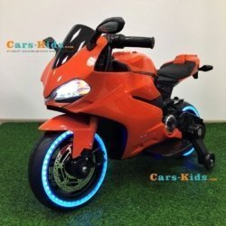 Детский электромотоцикл Ducati 12V- FT-1628 оранжевый (колеса пластик с резиновой проставкой, сиденье кожа, музыка, страховочные колеса)